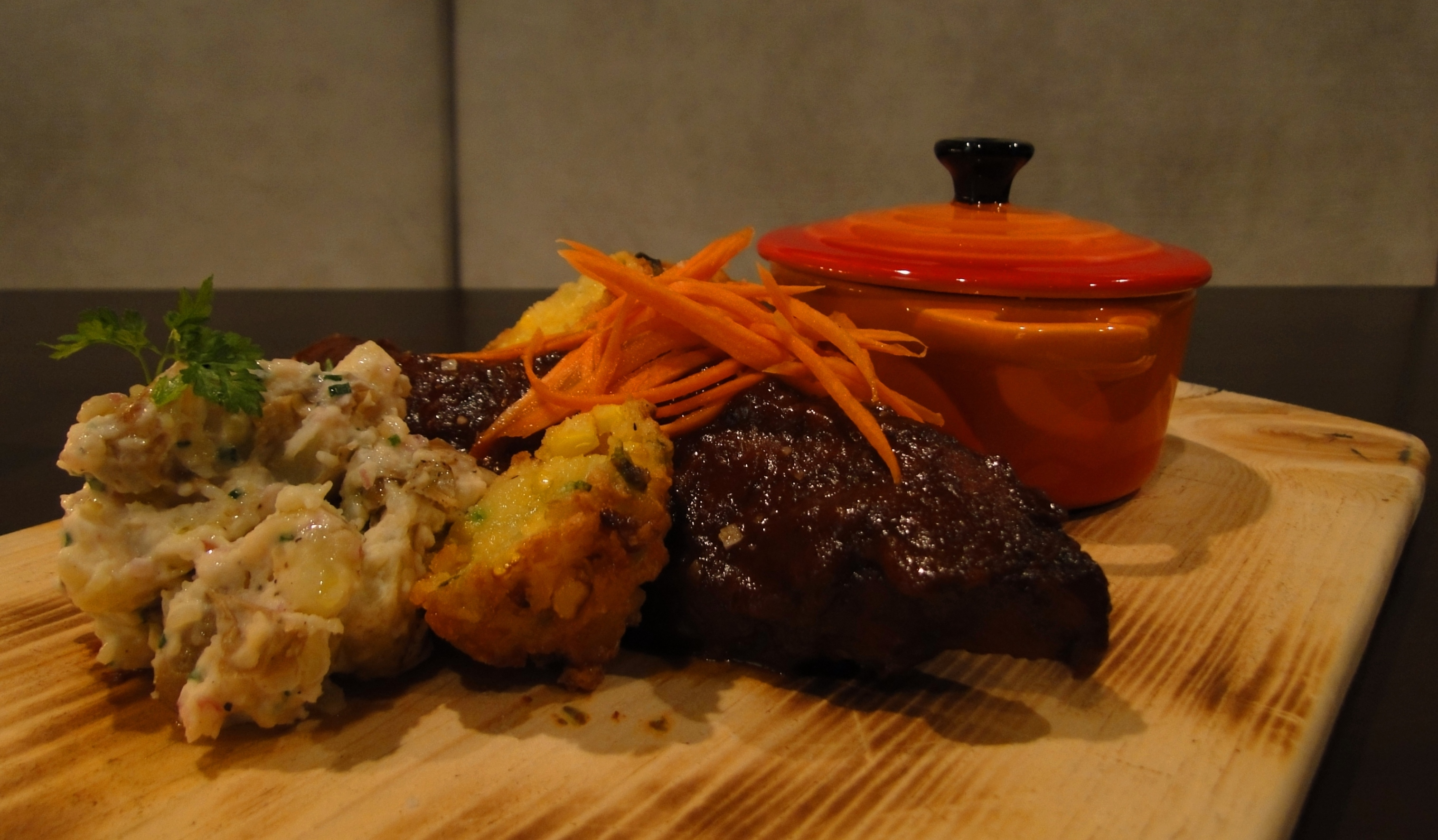 Chipotle smoked pork ribs with Jalapeño cheddar corn fritters, Bacon baked beans  and Potato salad..  picture