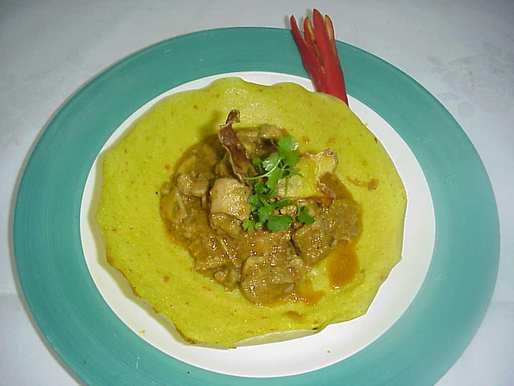 Indonesian lemongrass chicken with flavored appam picture