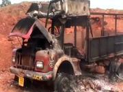 709052 Rebels Set 19 Miners Trucks Alight In Dispute