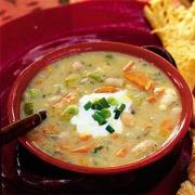 Chicken soup with shredded chicken pieces is full of proteins.