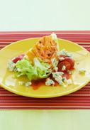 LETTUCE-WEDGE SALAD WITH TOMATO AND BACON DRESSING