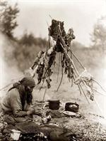 Woman using Navajo cooking tools!