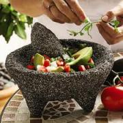 Season a molcajete before using it for crushing ingredients
