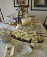 Table setting for high tea needs a friendly and personal touch.