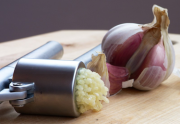 Use garlic press for chopping garlic quickly and efficiently