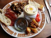 A typical English breakfast - coddled eggs served with bread and vegetables