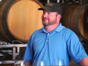 Wine Tasting In The Barrel Room of Bending Branch Winery