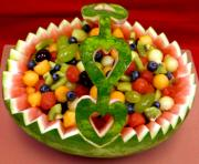Make a watermelon fruit basket and transform this simple fruit salad into an elegant fruit centerpiece.