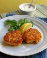 Crab cakes served with sauce