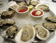 Typically raw oysters are served on a platter full of crusher ice