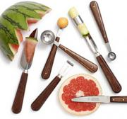 Various tools for preparing fruits garnish.