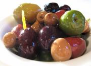 Different types of olives waiting to be pitted.