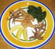 Kalamarakia Tiganita - Deep Fried Calamari is a popular dish in Greece