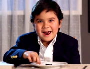 Kid tasting caviar