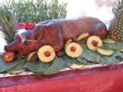 Decorating the BBQ whole pig can be as interesting as the BBQ itself