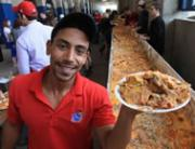 One of the volunteers displaying a portion of the record-breaking nachos