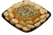 Serve your spinach bread dip in a fancy way and complement it with the right kind of bread and dipper.