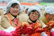 South Korean women prepare kimchi for the needy.