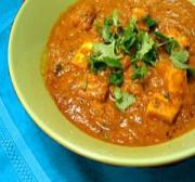 Paneer masala garnished with coriander leaves