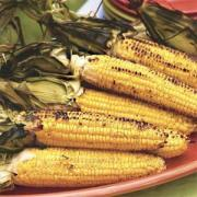 Grilled corn in the husk ready to serve