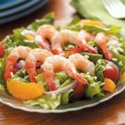 French salad with shrimps and greens