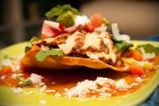 Tostadas is a generic term for fried tortillas with various toppings.