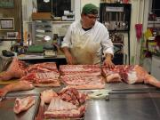 A butcher's work involves slaughtering animals and cutting up meat in ways as desired by the customer