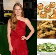 Amy Adams enjoys signature appetizers at premiere party.