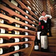Charlie Trotter's wine cellar, already auctioned, now his restaurant is on the line as well.