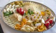 A cheese platter contains a variety of cheeses