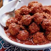 Meatballs ready to be eaten with a spicy sauce
