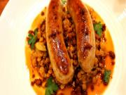 Italian Sausages with Braised Lentils and Crispy Chorizo