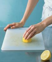 Using lemons to clean chopper boards