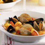 Bouillabaisse - a fish soup containing different fishes, shell fishes and vegetables, flavored with spices and served with bread