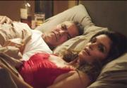 George Clooney and Cindy Crawford in bed together. Don't miss the tequila bottle in the corner.