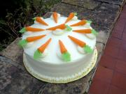 Marzipan carrots are used to decorate the cakes.