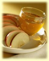 Apple slices dipped in honey - popular food custom of Rosh Hashannah