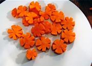 Vibrant carrot garnish can make a dish look most attractive.