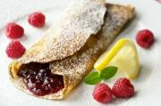 Jam filled crepes served for breakfast
