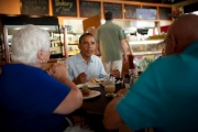 Obama enjoys his breakfast with Seniors.