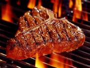 cooking steaks on a grill
