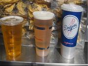 Couple Proves Hockey Arena's Small and Large Beers Are The Same Size