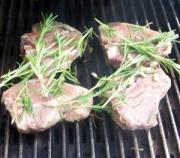 Lamb steaks to be grilled.