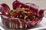 Beet Carrot and cucumber pulp salad spread over radicchio leave