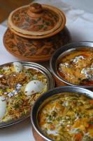 A bowl of Hyderabadi Biryani served with boiled egg as is the norm in Indian Restaurants.