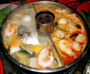 A hot pot with seafood and meat