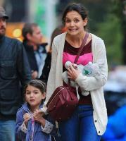 Katie Holmes and daughter Suri pull faces on the papparazzis.