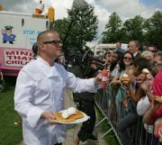 Heston Blumenthal distributing samples of his record-breaking ice cream cone himself.