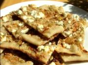 Pumpkin Seed Flatbread Topped With Sweet Onions And Feta
