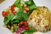 Neatly cut halibut steak for salad